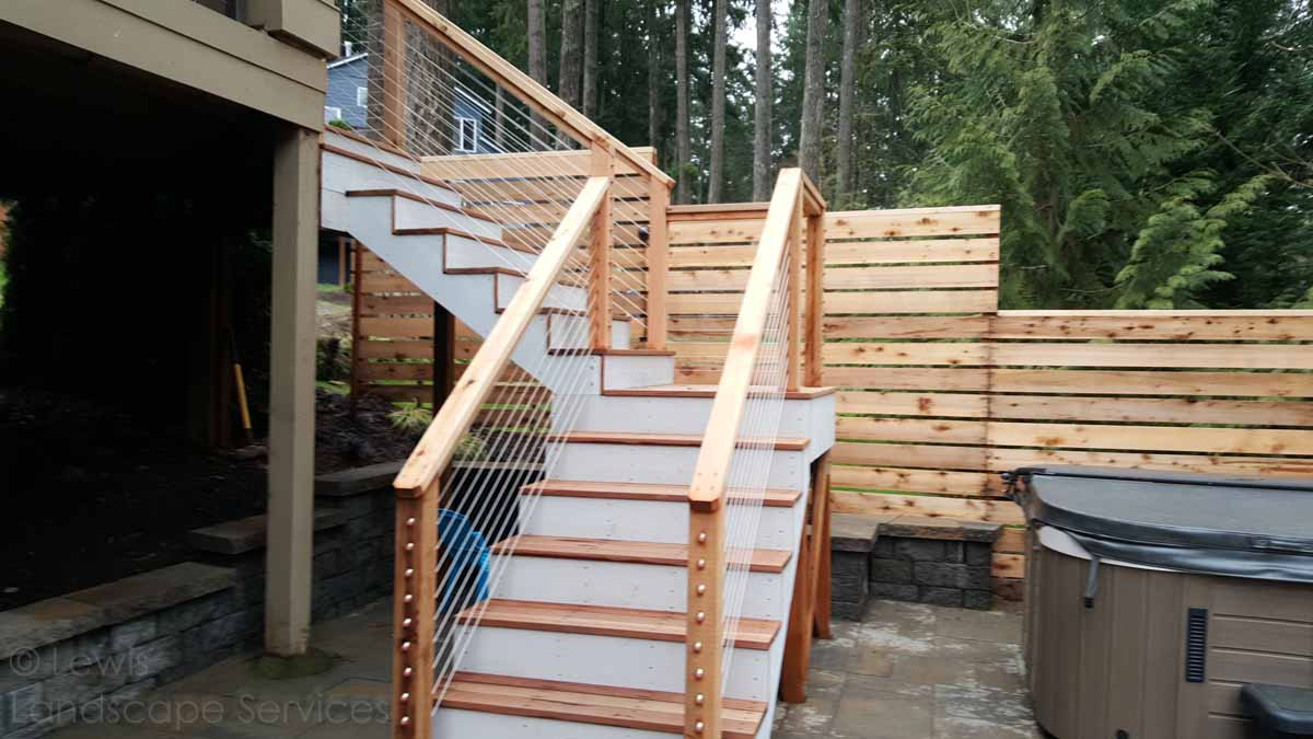 Cedar Decking with Cable Railing at one of our deck installers in Tigard, OR