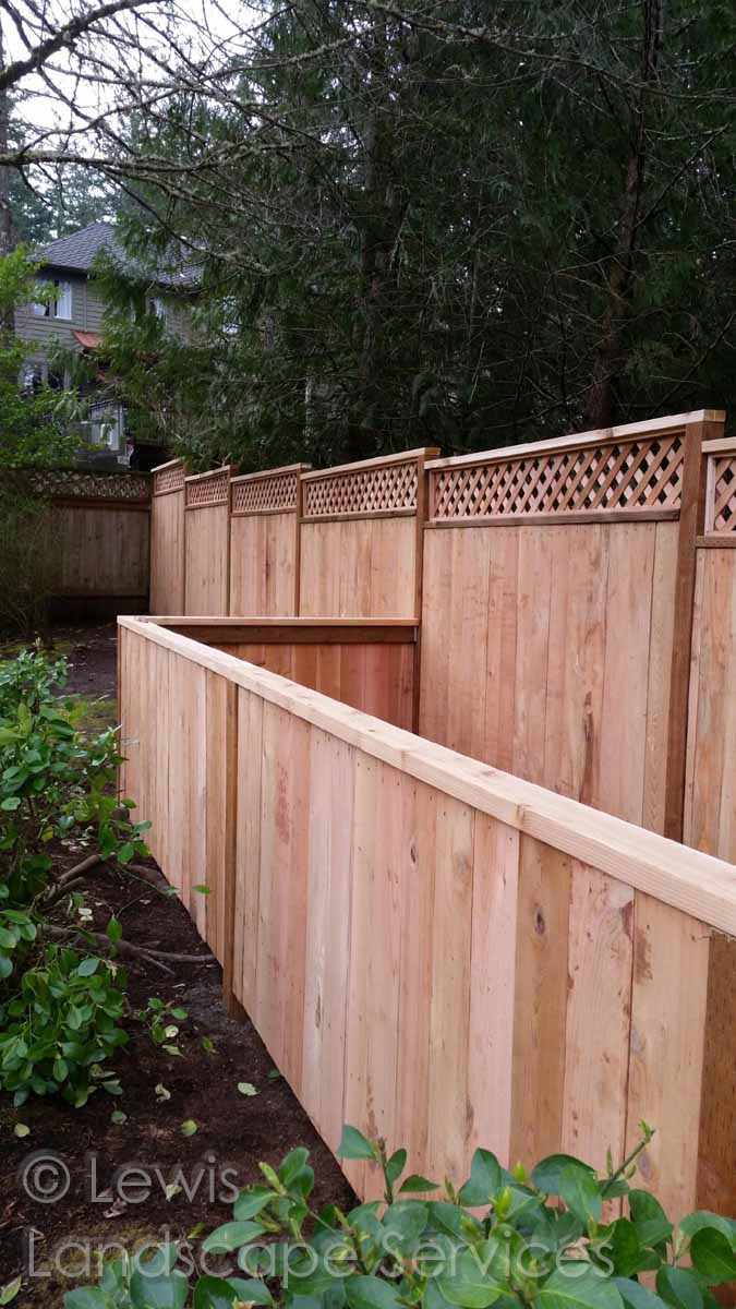 Custom built cedar solid style fence with lattice top & utility area at Portland Oregon fence installation job we did