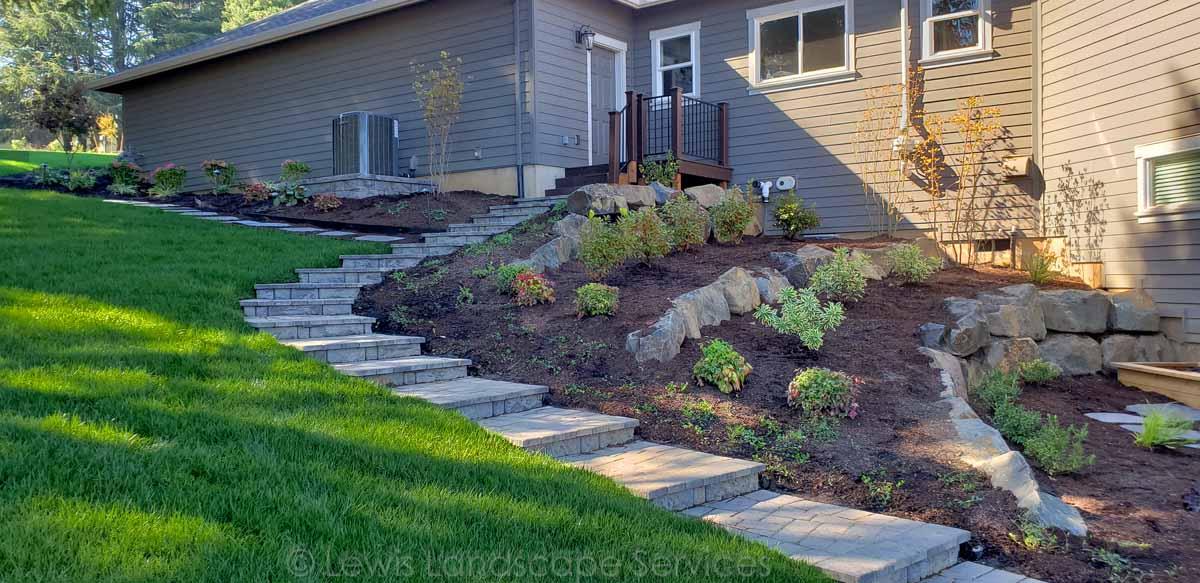 Paver Steps, Terraced Basalt Boulder Walls, Plantings