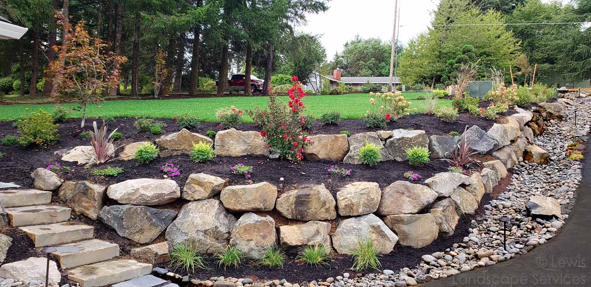 Basalt Boulder Rock Walls, Rock Slab Steps, French Drain/Dry Streambed, Plantings