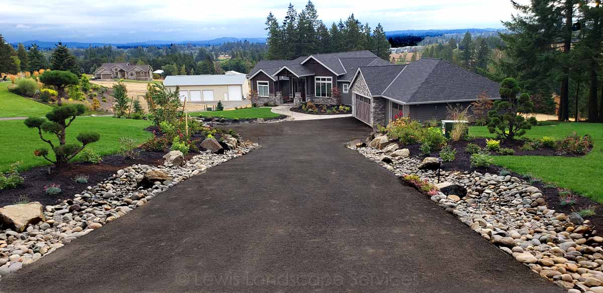 New Sod Lawn, French Drains/Dry Streambed, Rock Work, Plants & Trees