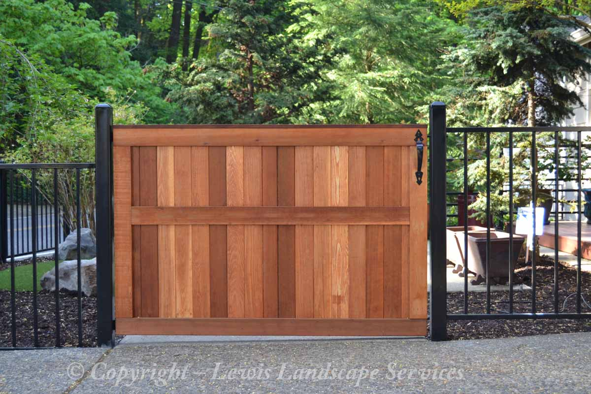 Custom Cedar Gate Built Into Iron Fence we Fabricated & Installed at this property in Portland, Oregon - fence installation companies