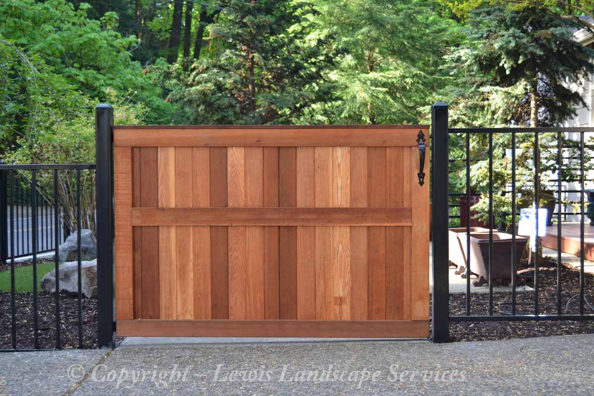 Custom Cedar Gate & Iron Fencing