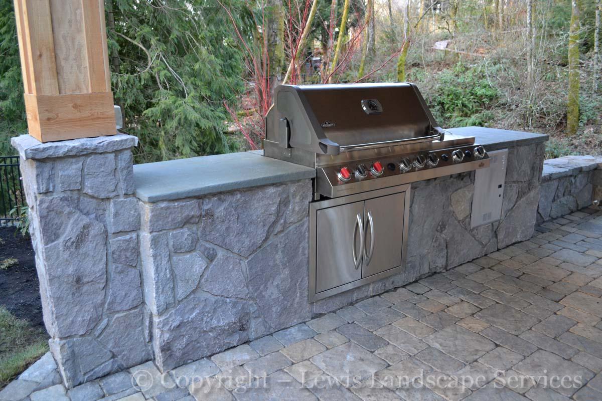 Outdoor Kitchen, BBQ, SS Doors, Stone Veneer, Limestone Countertops