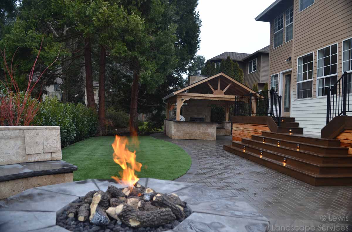 Paver Patio, Seat Wall, Fire Pit, Deck, Lighting, Covered Structure