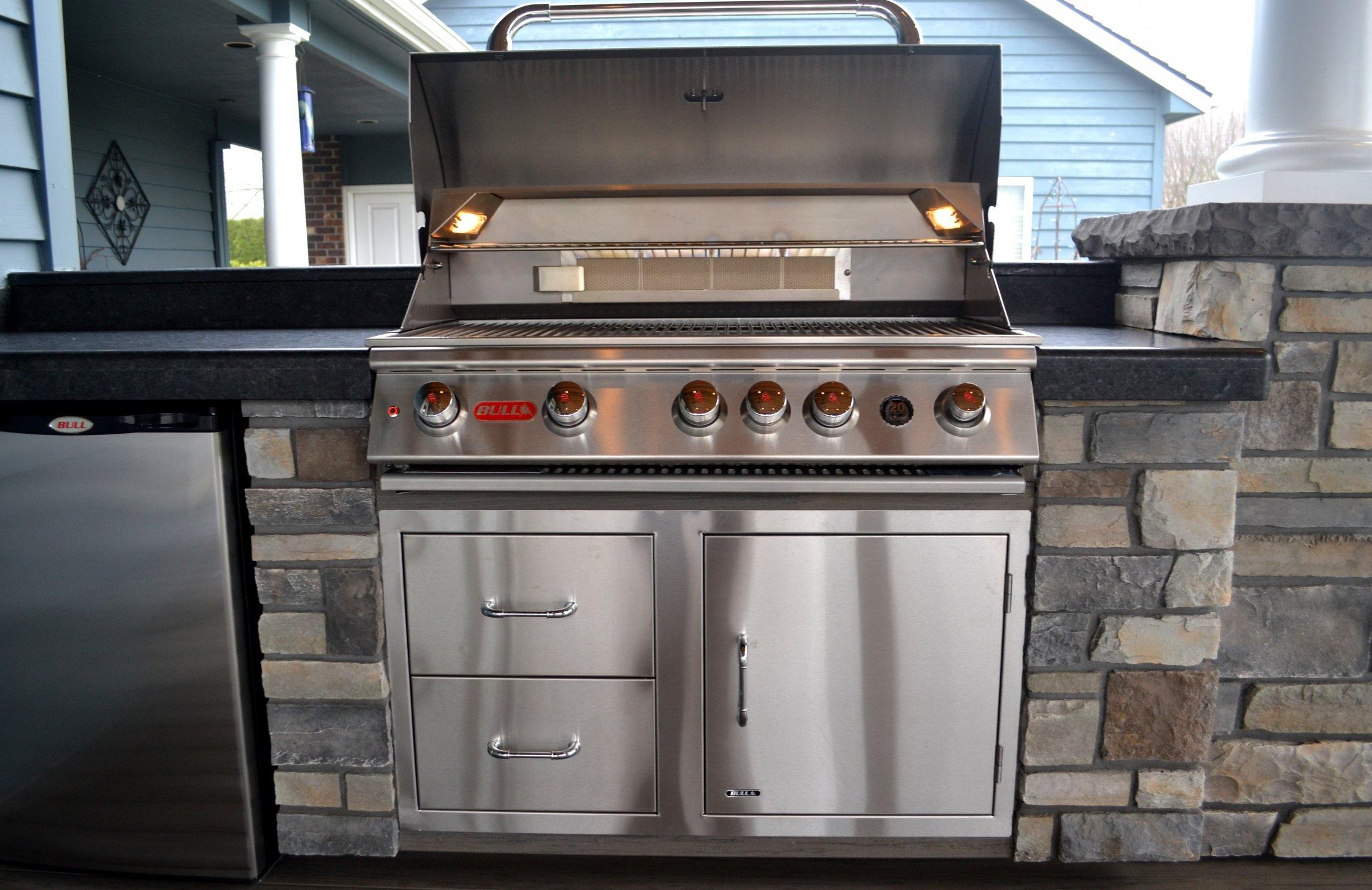 Outdoor Kitchen with BBQ, Fridge, Concrete Slab Countertops