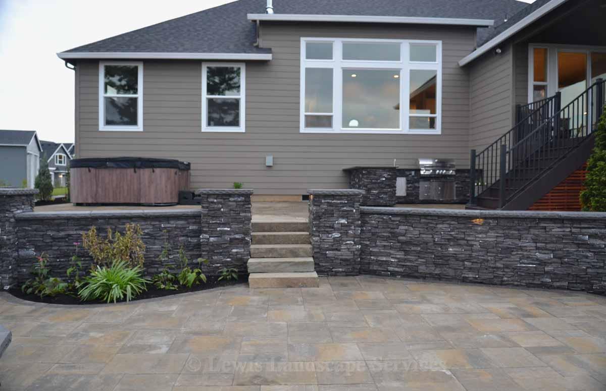 Paver Patio, Rock Slab Steps, Seat Walls & Columns, Outdoor Kitchen, Spa