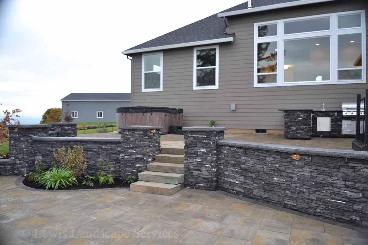 Paver Patio, Stone Walls & Partial View of Outdoor Kitchen
