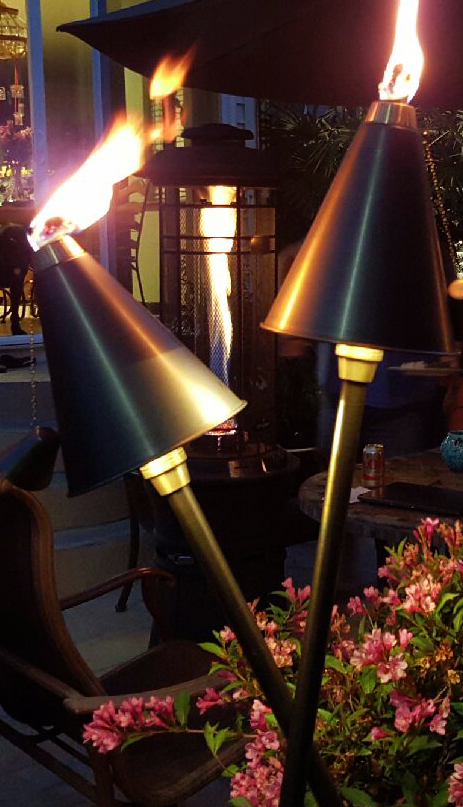 These Tiki Torch Lights are a Specialty Accent Light. At 5' Tall, they illuminate the area below as well as being a functional tiki torch on top, when desired.