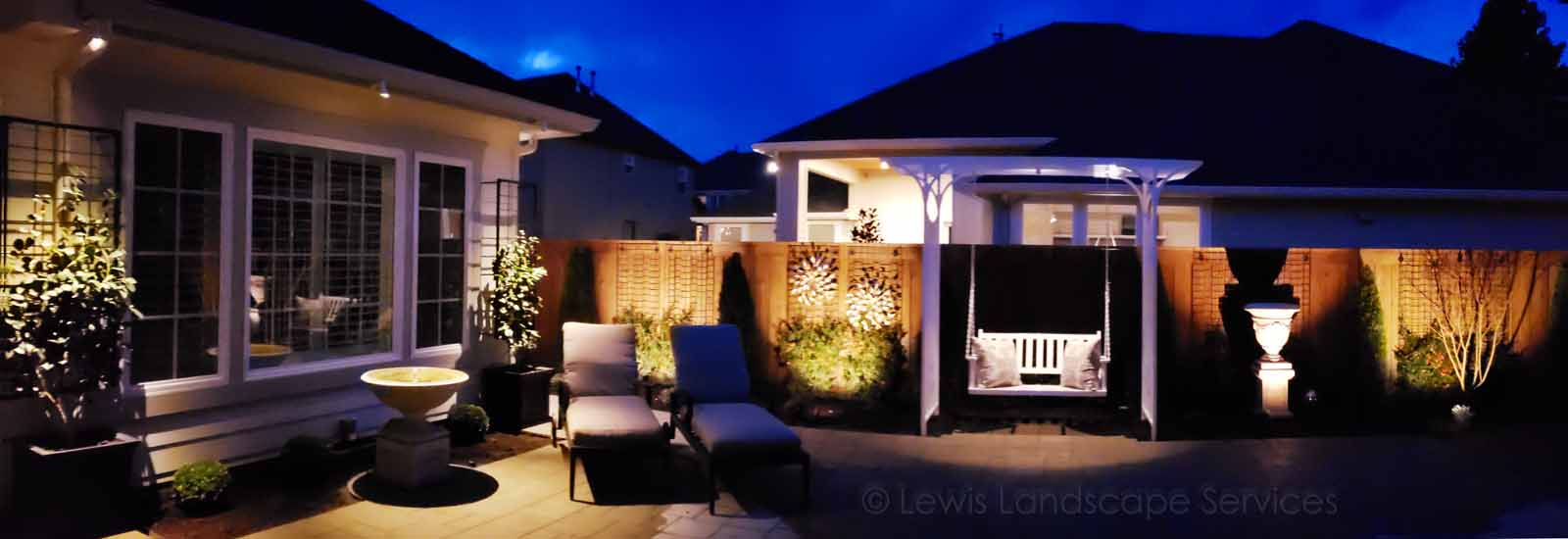 Overall photo of back yard landscape lighting job we did in Wilsonville, OR