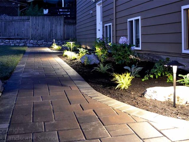 LED Path Light Fixtures Illuminating Paver Pathway at this job we did in Beaverton