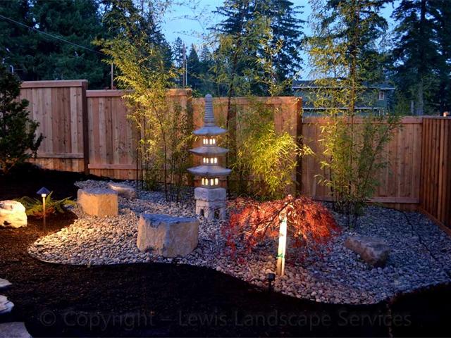 Custom Lighting Built Into Pagoda Statuary with additional landscape lighting around the back yard