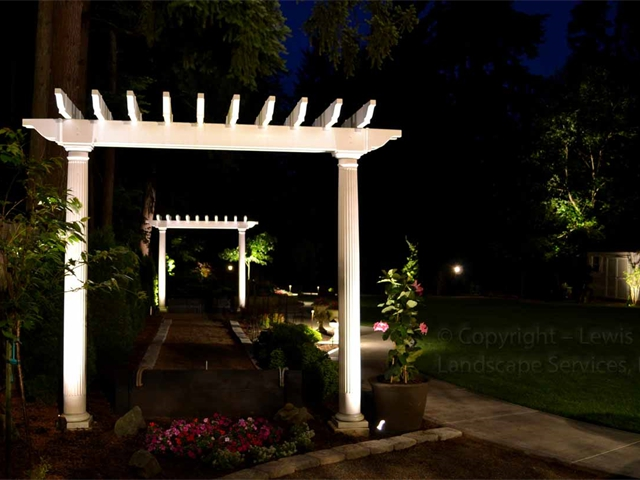 Uplighting Some Arbors in a Back Yard Landscape with LED Light Fixtures at a job in Lake Oswego