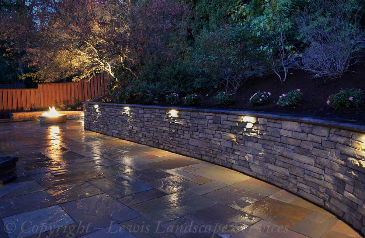 Lighting Built Into Stone Retaining Wall with Landscape Lighting at a Job in Portland