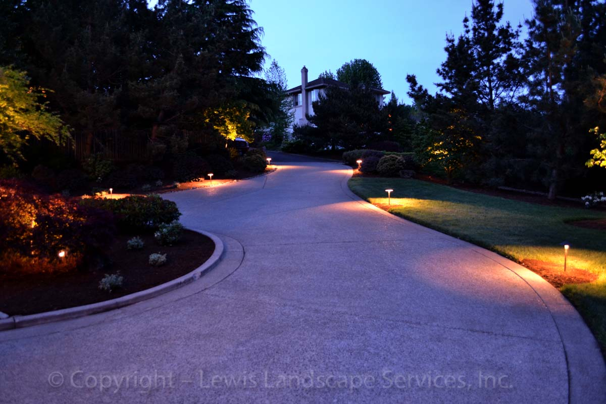 Path Lights along driveway at one of our landscape lighting installations in Portland, OR