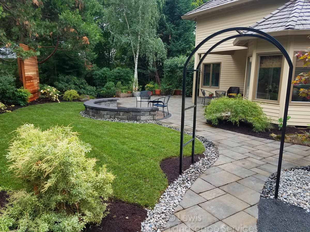 Paver Pathway & Patio, Seat Wall, New Sod Lawn, Planting