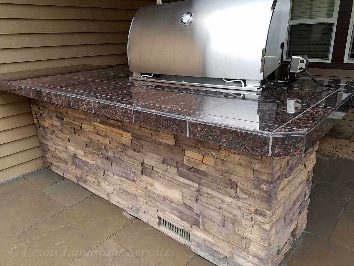 Outdoor Kitchen With Granite Tile Countertops Stone Siding Bbq