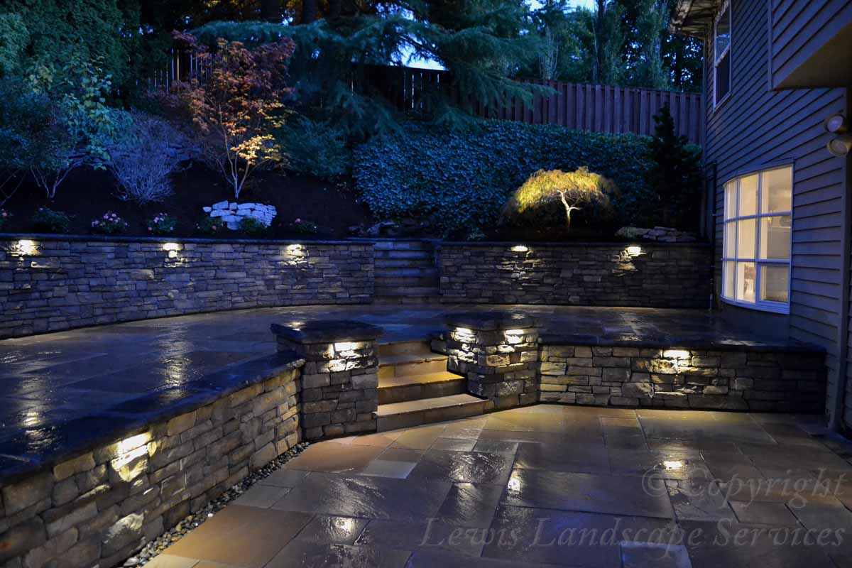 Lighting Built Into Stone Retaining Wall with Landscape Lighting at a Job in Portland, OR