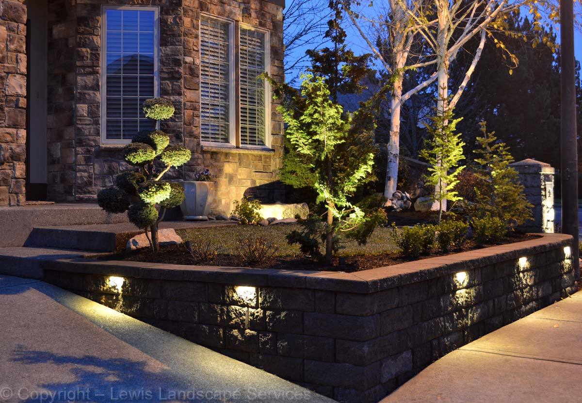 Outdoor lights built into retaining wall & landscape lighting in front yard at job we did in Tigard, OR
