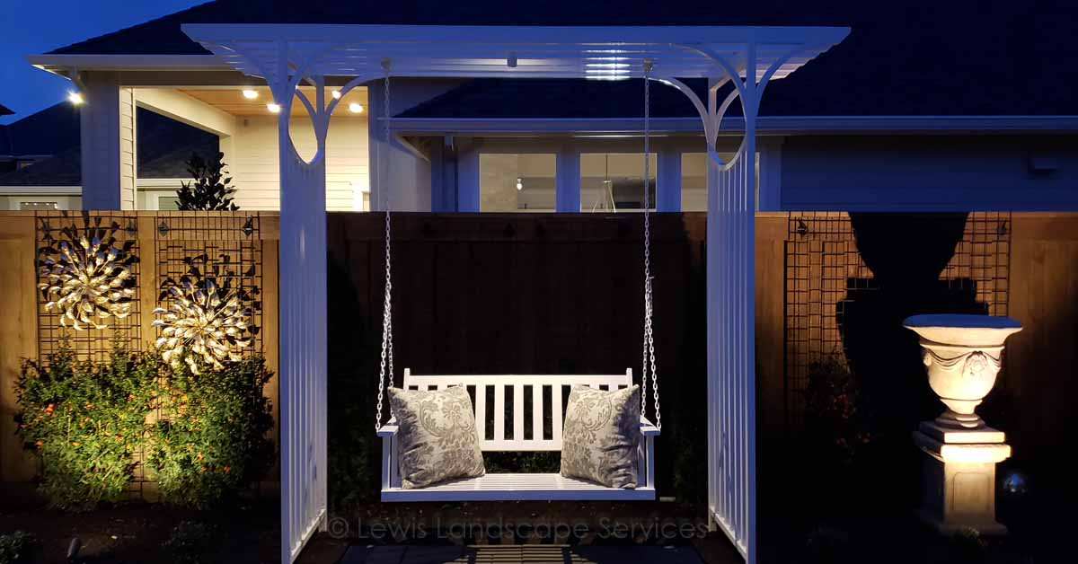 The Bench Hanging from an Arbor is Illuminated from Above & Other Landscape Lighting Effects at a Job we did in Wilsonville, OR