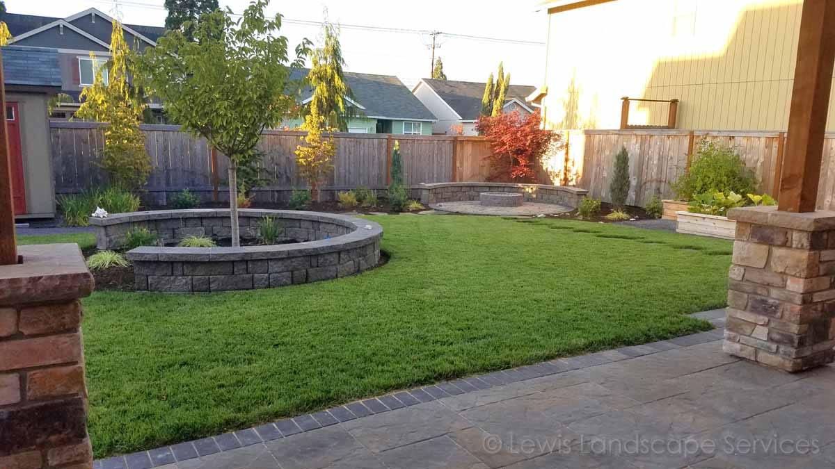 Walls, Fire Pit Area, Sod Lawn, Patio, Stone Columns on Covered Structure