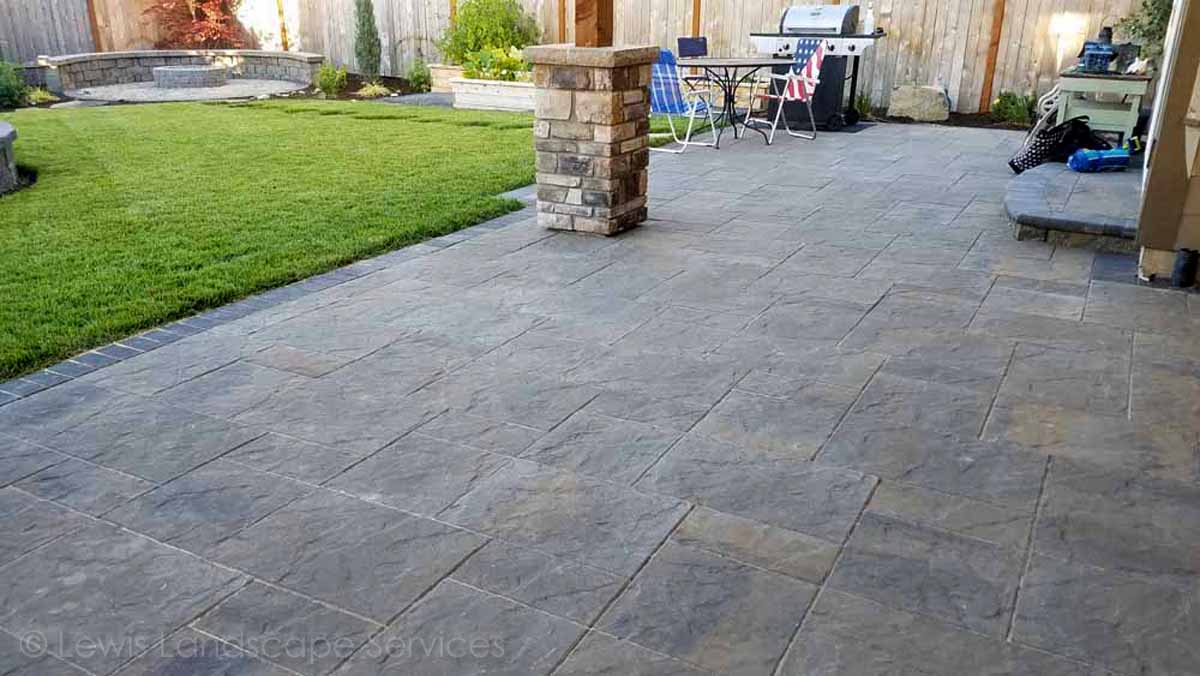Paver Patio, Stone Columns on Covered Structure, Sod Lawn
