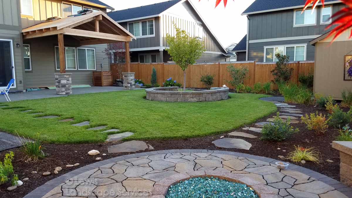 Paver Patio, Fire Pit, Stone Steps, Sod Lawn, Seat Wall, Planting, More....