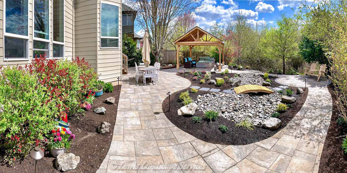 Panoramic View of Stand Alone Covered Structure - Open Gable, Paver Patio, Paver Pathways, Dry Streambed Landscape, New Plants & Trees, Outdoor Lighting