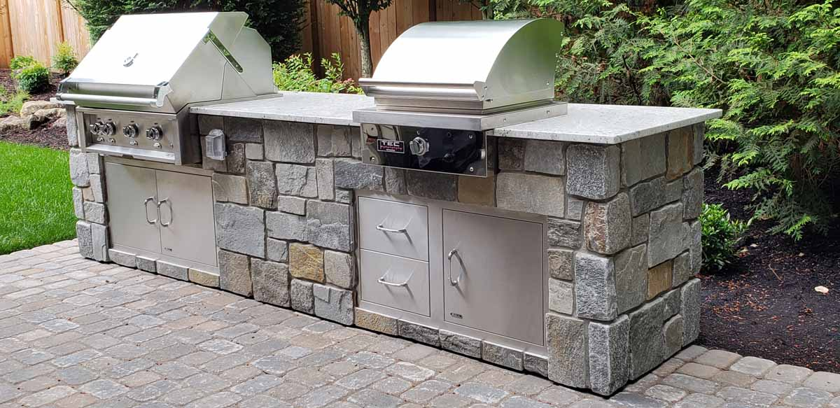 Outdoor Kitchen with BBQ and Searing Station, Granite Slab, Stone, SS Doors