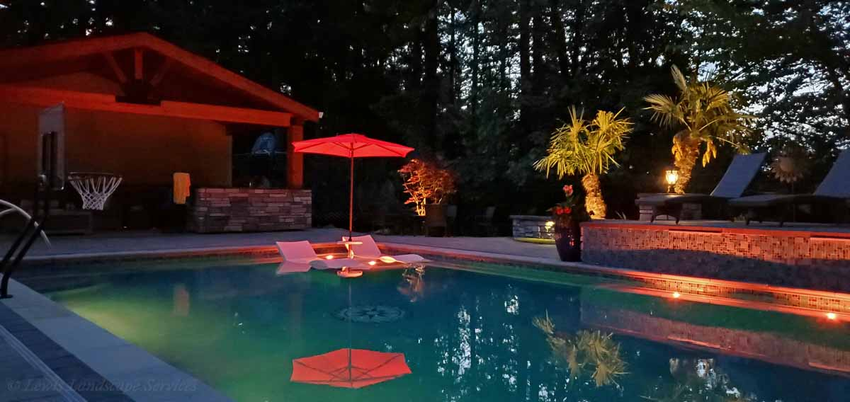 Mixture of Tree Uplighting & Pool Lighting from one of our Installations in Beaverton