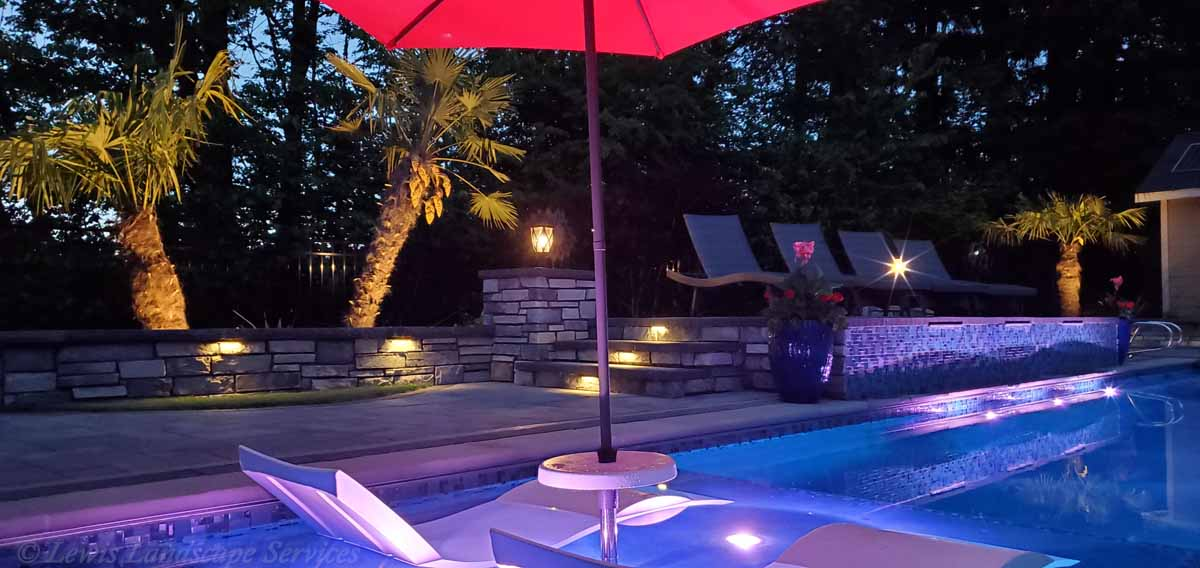 Mixture of Tree Uplighting, Hardscape Lights, Post Lights & Pool Lighting from one of our Installations in Beaverton