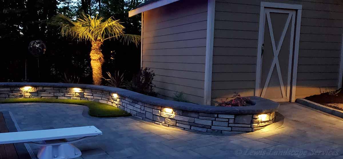 Hardscape Lighting on Seat Wall & Uplighting on Palm Tree