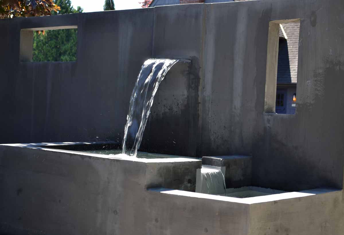 Custom Waterfalls Built Into Concrete Wall