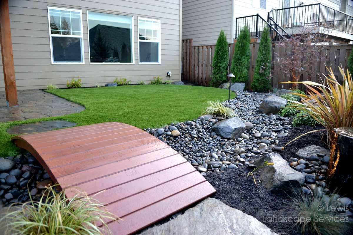 Synthetic Turf, Dry Streambed, Planting, Lighting, Footbridge
