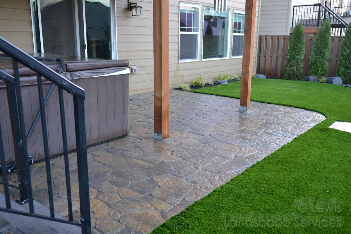 Close-up of Paver Patio & Synthetic Turf Installation
