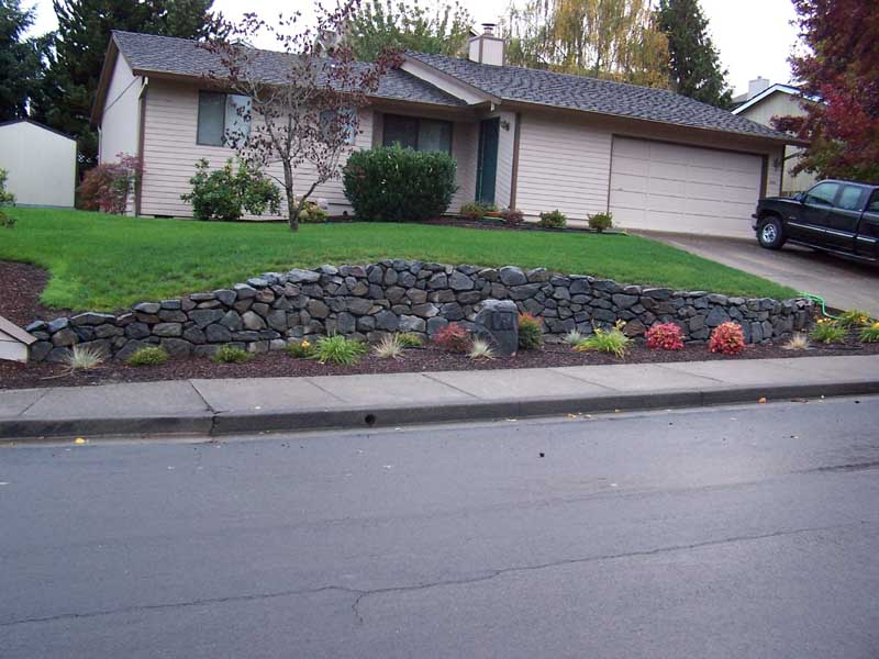 Before-after-new-rock-wall 003
