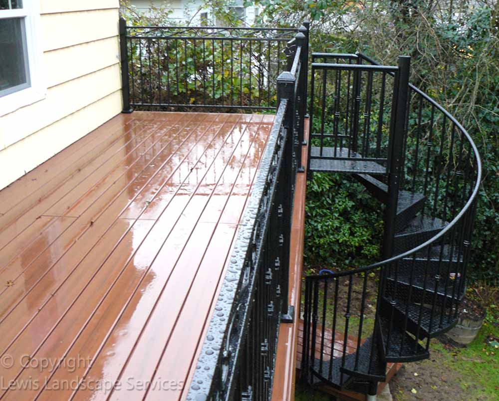 TimberTech Deck , Decorative Iron Railing & Iron Spiral Staircase at one of our deck installations in Beaverton, OR