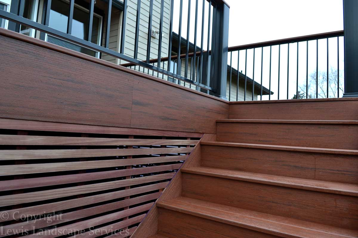 Decorative Iron Deck Railing, Steps & Cedar Screening at one of our deck installations in Portland, OR