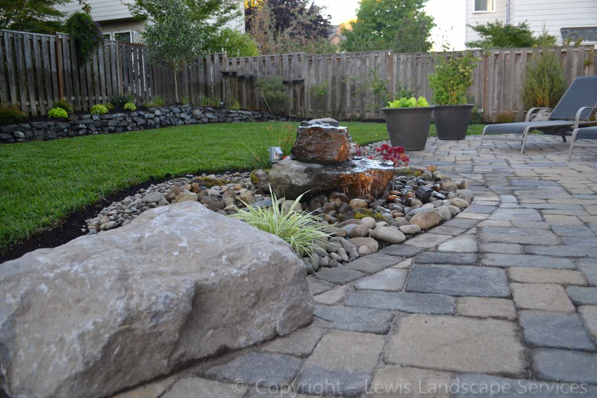 Back Yard Paver Patio, Rock Bubbler Fountain, New Sod Lawn