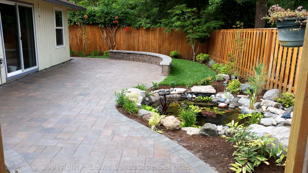 Back Yard Paver Patio, Seat Wall, Pond/Waterfall, Sod Lawn