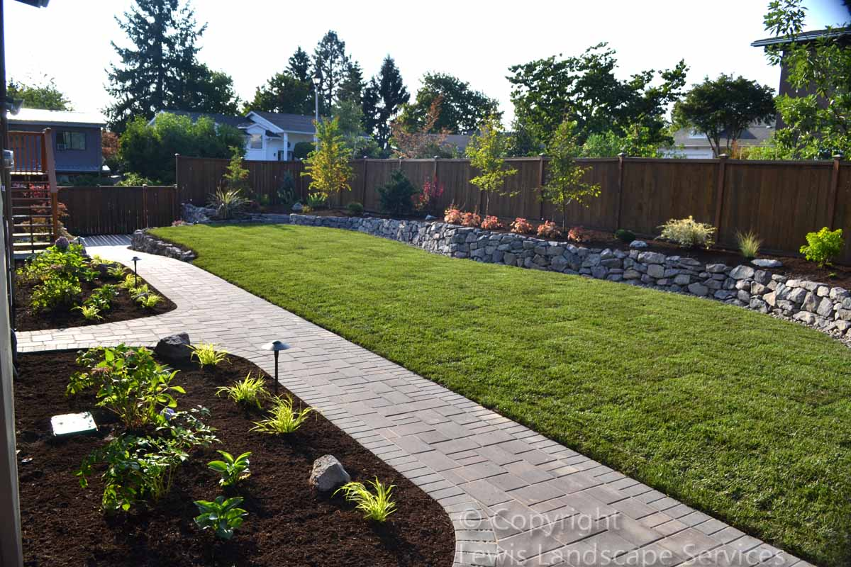 Paver Pathways, Basalt Rock Walls, New Sod Lawn, Plants & Trees