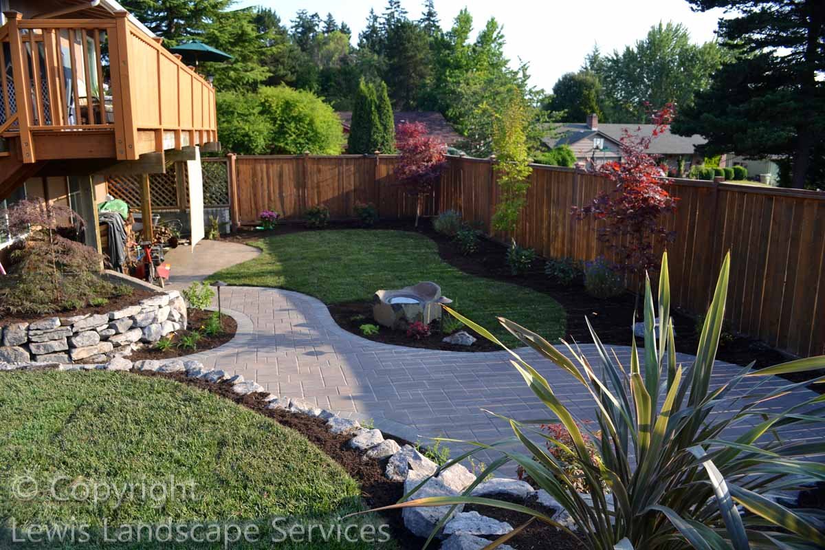 Paver Patio & Pathways, Basalt Rock Walls, New Sod Lawn, Plants & Trees