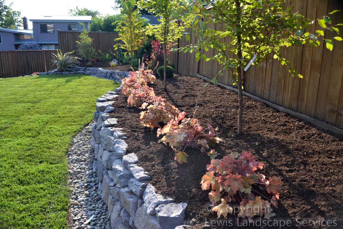 Closeup of Rock Wall, Sod Lawn & Plants