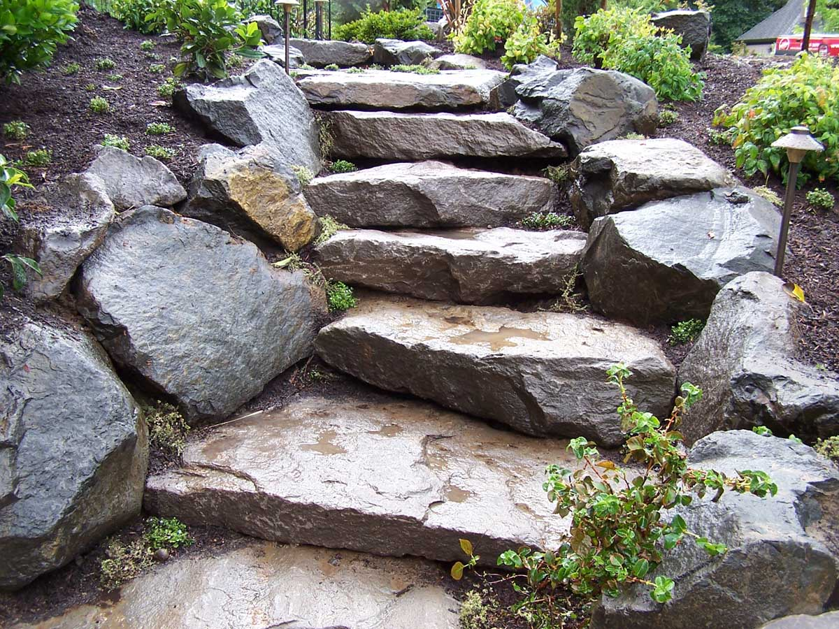 Full-landscape-projects-malone-project-2008-rock-slab-steps-going-down-to-back-yard 002