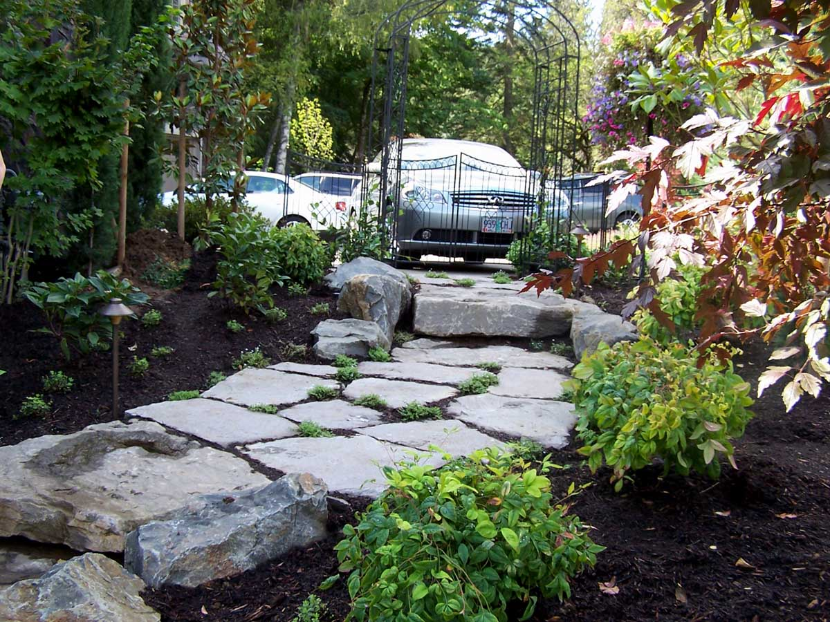 Full-landscape-projects-malone-project-2008-rock-slab-steps-going-down-to-back-yard 004