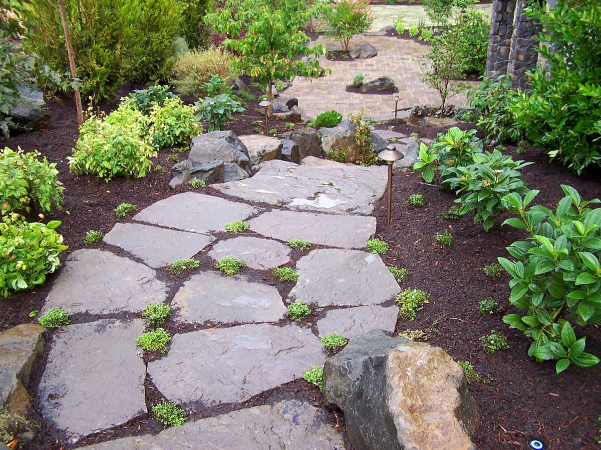 Full-landscape-projects-malone-project-2008-rock-slab-steps-going-down-to-back-yard 005