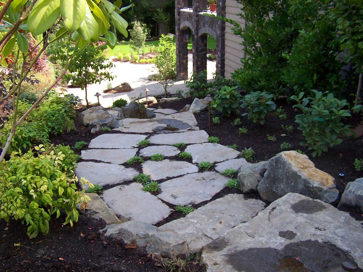 Full-landscape-projects-malone-project-2008-rock-slab-steps-going-down-to-back-yard 008
