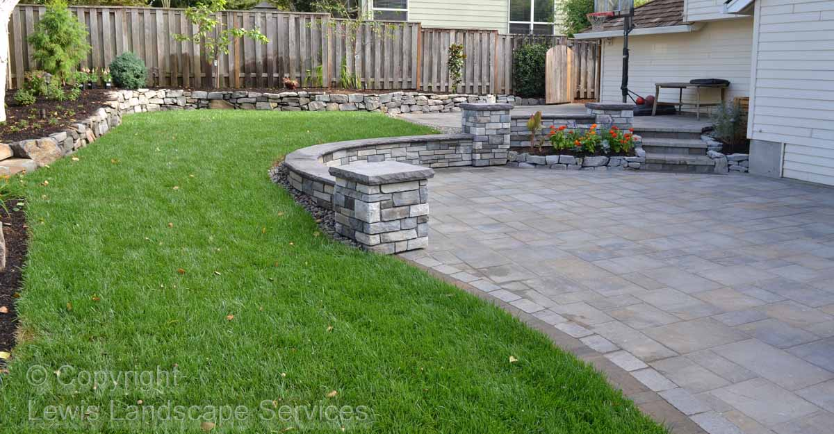 Sod Lawn, Rock Walls, Stone Seat Wall & Columns, Paver Patio, Plants