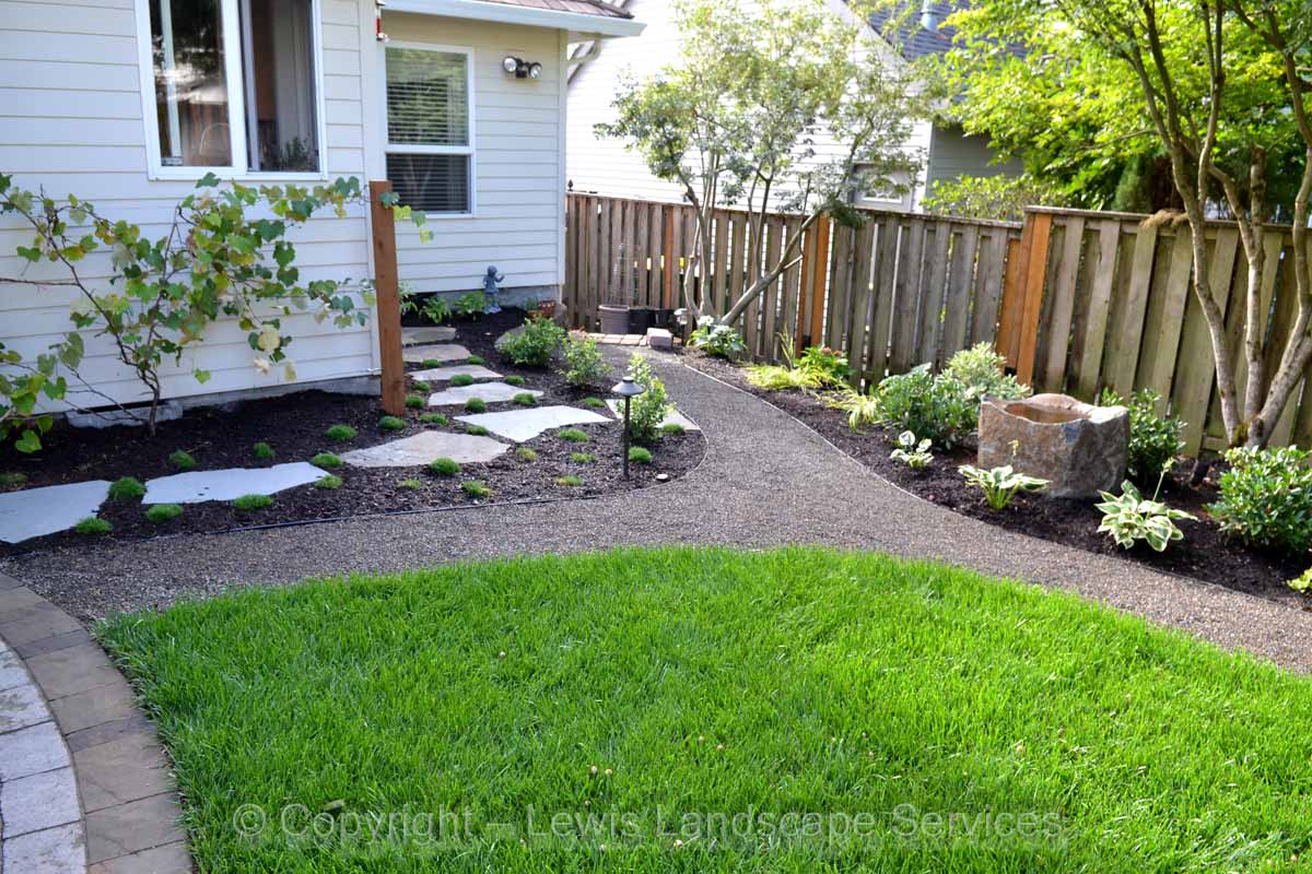 Lower Part of Yard - Sod Lawn, Flagstone Steps, Grape Vine Arbor, Gravel Pathway