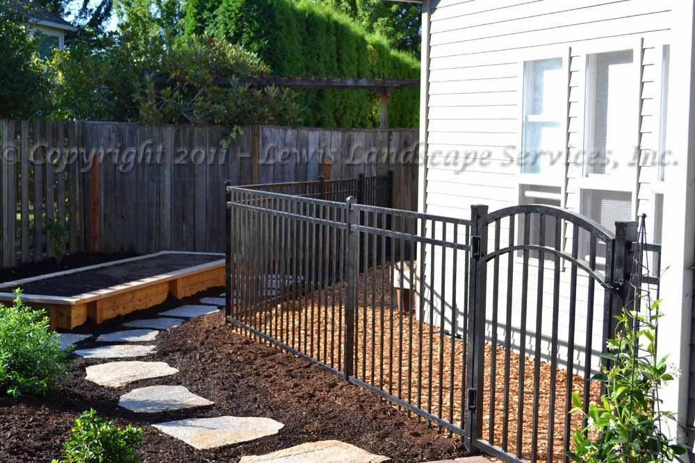 Iron Fence & Gate, Flagstone Steps, Raised Garden Box